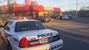 Police are seen outside a Scarborough Pita Pit where a male was shot on Apr. 22, 2017. (Cristina Tenaglia/CP24)