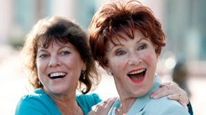 "In this June 18, 2009 file photo, actresses Erin Moran, left, and Marion Ross pose together at the Academy of Television Arts and Sciences' ""A Father's Day Salute to TV Dads"" in the North Hollywood section of Los Angeles. Moran, the former child star who played Joanie Cunningham in the sitcoms ""Happy Days"" and ""Joanie Loves Chachi,"" has died at age 56. Police in Harrison County, Indiana said that she had been found unresponsive Saturday, April 22, 2017, after authorities received a 911 call. (AP Photo/Matt Sayles, File)"