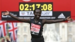 Kenya's Mary Keitany poses for photographers at the finish line after winning the London Marathon in London on, Sunday, April 23, 2017. (AP Photo/Tim Ireland)