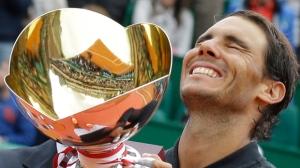 Spain's Rafael Nadal holds up his trophy after winning his men's finals match against Spain's Albert Ramos-Vinolas at the Monte Carlo Tennis Masters tournament in Monaco, Sunday, April, 23, 2017. (AP Photo/Claude Paris)