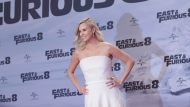 Actress Charlize Theron poses for photographers upon arrival at the premiere of the film 'The Fate of the Furious' in Berlin, Tuesday, April 4, 2017. (AP Photo/Michael Sohn)