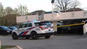 Police investigate a shooting at an apartment building in the Dixon Road and Kipling Avenue area Sunday April 23 2017.
