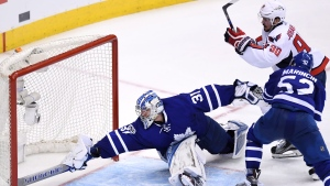Washington Capitals centre Marcus Johansson (90) scores against Toronto Maple Leafs goalie Frederik Andersen (31) as defenceman Martin Marincin (52) defends during the first overtime period of game six in an NHL Stanley Cup hockey first-round playoff series in Toronto on Sunday, April 23, 2017. THE CANADIAN PRESS/Frank Gunn