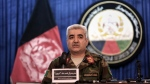 In this Feb. 18, 2017 photo, Afghan Army Chief of Staff, General Qadam Shah Shahim, speaks during a news conference in Kabul, Afghanistan. Afghan officials said the country's army chief and the defense minister have resigned following the weekend Taliban attack at a northern army base that killed more than 100 military and other personnel. The officials said that President Ashraf Ghani accepted the resignations on Monday, April 24, 2017. (AP Photo/Rahmat Gul)