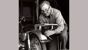 This 1975 image released by William Morrow shows author Robert M. Pirsig working on a motorcycle. (William Morrow via AP)