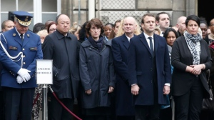 French centrist presidential candidate Emmanuel Macron, second right, attends a ceremony for slain police officer Xavier Jugele, at the Paris Police headquarters, Tuesday, April 25, 2017. France's top officials and presidential candidates are attending a national ceremony to honor the police officer killed by an Islamic extremist on the Champs-Elysees. (AP Photo/Thibault Camus, Pool)