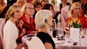 Ivanka Trump, daughter and adviser of U.S. President Donald Trump, left, listens to a speech of German Chancellor Angela Merkel during a dinner after she participated in the W20 Summit in Berlin Tuesday, April 25, 2017. (AP Photo/Michael Sohn, pool)