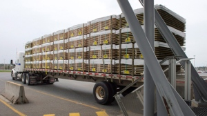 A truck carrying wood goes through the customs checkpoint, Tuesday, April 25, 2017 in Champlain, N.Y. Canadian lumber imports into the United States are expected to face new duties ranging from three to twenty-four per cent THE CANADIAN PRESS/Ryan Remiorz