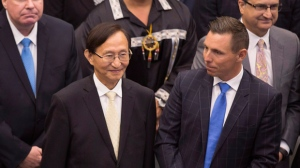 Ontario Provincial Conservative Leader Patrick Brown, right, introduces newly-elected Scarborough-Rouge River MPP Raymond Cho, following the Lieutenant Governor of Ontario's Speech from the Throne, opening the second session of the 41st Parliament of Ontario, in Toronto on Monday Sept. 12, 2016. THE CANADIAN PRESS/Peter Power