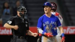 Toronto Blue Jays' Chris Coghlan, right, yells as he strikes out while home plate umpire Toby Basner, left, and Los Angeles Angels catcher Martin Maldonado stand in the background during the ninth inning of a baseball game, Monday, April 24, 2017, in Anaheim, Calif. (AP Photo/Mark J. Terrill)