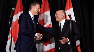 Conservative Party leadership candidate Maxime Bernier (left) shakes hands with Kevin O'Leary at a news conference in Toronto on Wednesday after it was announced that O'Leary had quit the leadership race and thrown his support behind Bernier. (Nathan Denette/The Canadian Press)
