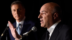 Conservative Party leadership candiidate Maxime Bernier (left) looks on as Kevin O'Leary address a news conference in Toronto on Wednesday. (Nathan Denette/The Canadian Press)