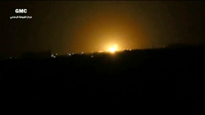 This frame grab from video provided by the Syrian anti-government activist group Ghouta Media Center, which has been authenticated based on its contents and other AP reporting, shows flames rising after an explosion near an airport west of Damascus, Syria, Thursday, April 27, 2017. Syria's state media reported Thursday that Israel has attacked a military installation near the Damascus International Airport. SANA says Israel fired several missiles from inside the occupied Golan Heights south of the capital at a military installation near the capital's main airport, triggering several explosions and causing damage. (Ghouta Media Center via AP)
