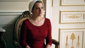 This image released by Hulu shows Elisabeth Moss as Offred in a scene from, 'The Handmaid's Tale,' premiering Wednesday on Hulu with three episodes. (George Kraychyk/Hulu via AP)