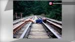 This photo posted to Instagram and confirmed to be of Marisa Lazo shows the woman lying across train tracks.