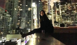 This photo posted to Instagram and confirmed to be of Marisa Lazo shows the 22-year-old woman sitting on the rooftop of a downtown high-rise. (Instagram / Lazodelmar)