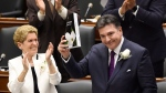 Ontario Finance Minister Charles Sousa, right, delivers the 2017 Ontario budget next to Premier Kathleen Wynne at Queen's Park in Toronto on Thursday, April 27, 2017. THE CANADIAN PRESS/Nathan Denette