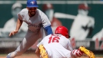 St. Louis Cardinals' Kolten Wong (16) is safe at second for a double ahead of the tag from Toronto Blue Jays second baseman Devon Travis during the fifth inning in the first game of a baseball doubleheader. (Jeff Roberson/AP Photo)