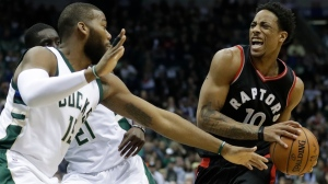 Toronto Raptors' DeMar DeRozan drives against Milwaukee Bucks' Greg Monroe during the first half of game 6 of an NBA first-round playoff series basketball game on Thursday. (Morry Gash/AP Photo)