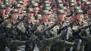 In this April 15, 2017, file photo, soldiers march across Kim Il Sung Square during a military parade in Pyongyang, North Korea, to celebrate the 105th birth anniversary of Kim Il Sung, the country's late founder and grandfather of current ruler Kim Jong Un. North Korean fury at Washington was rising well before U.S. President Donald Trump took office, in particular over reports that annual U.S.-South Korean military exercises now include training for precision strikes on the North's leadership or nuclear and military facilities. (AP Photo/Wong Maye-E)