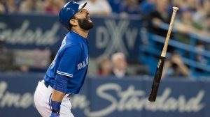 Toronto Blue Jays' Jose Bautista reacts after popping up against the Tampa Bay Rays in the seventh inning of their AL baseball game in Toronto on Friday. (Fred Thornhill/The Canadian Press)