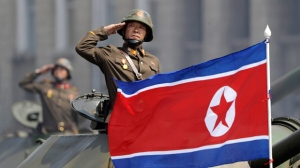 In this Saturday, April 15, 2017, file photo, a North Korean national flag flutters as soldiers in tanks salute to North Korean leader Kim Jong Un during a military parade in Pyongyang, North Korea to celebrate the 105th birth anniversary of Kim Il Sung, the country's late founder and grandfather of the current ruler. A North Korean mid-range ballistic missile apparently failed shortly after launch Saturday, April 29, South Korea and the United States said, the third test-fire flop just this month but a clear message of defiance as a U.S. supercarrier conducts drills in nearby waters. (AP Photo/Wong Maye-E, File)