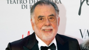 "In this May 22, 2016 file photo, director Francis Ford Coppola poses for photographers as he arrives for the premiere of Verdi's ""La Traviata'' at the Rome Opera House, in Rome.  (AP Photo/Andrew Medichini, File)"