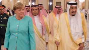 In this photo released by the Saudi Press Agency, SPA, German Chancellor Angela Merkel, left, is received by Saudi king Salman, right, on her arrival to Jiddah, Saudi Arabia, Sunday, April 30, 2017. Merkel arrived Sunday for talks with the oil-rich kingdom's monarch, beginning a two-nation trip to the Gulf. (Saudi Press Agency via AP)