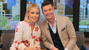 """In this photo released by Disney/ABC Home Entertainment and TV Distribution, Kelly Ripa and Ryan Seacrest pose for a photo at """"Live"""" on Monday, May 1, 2017, in New York. (Pawel Kaminski/Disney/ABC Home Entertainment and TV Distribution via AP)"""