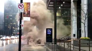 Heavy smoke was seen wafting through a sewer grate in the financial district on Monday afternoon, police say.
