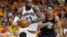 Cleveland Cavaliers' LeBron James (23) drives past Toronto Raptors' DeMar DeRozan (10) in the second half in Game 1 of a second-round NBA basketball playoff series. (Tony Dejak/AP Photo)