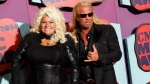 Beth Chapman, left, and Duane Chapman arrive at the CMT Music Awards at Bridgestone Arena, in Nashville, Tenn on June 4, 2014 . (Wade Payne / Invision)