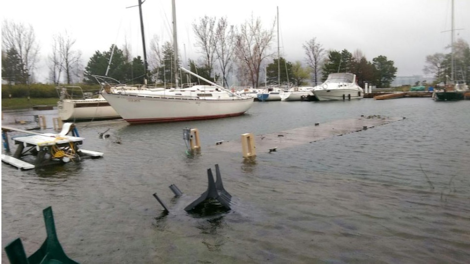 Boats docked at Toronto Islands Marina are being encroached on by Lake Ontario's rising water levels. The dock is submerged in the lake.  (Travis Dhanraj/CP24)