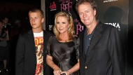 """In this Sept. 30, 2008, file photo, Conrad Hilton, left, Kathy Hilton, center, and Rick Hilton arrive at the launch party of new MTV series """"Paris Hilton's My New BFF"""" in Los Angeles. Paris Hilton's younger brother, Conrad Hilton, has been arrested in Los Angeles for allegedly stealing a car and violating an ex-girlfriend's restraining order. Police say the 23-year-old Hilton Hotel heir was arrested shortly before 5 a.m. Saturday, May 6, 2017, at a home in the Hollywood Hills. (AP Photo/Matt Sayles, File)"""