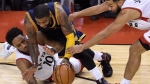 Cleveland Cavaliers guard Kyrie Irving (2) is fouled by Toronto Raptors guard DeMar DeRozan (10) as Raptors guard Cory Joseph (6) reaches in during second half NBA playoff basketball action in Toronto on Sunday, May 7, 2017. THE CANADIAN PRESS/Nathan Denette
