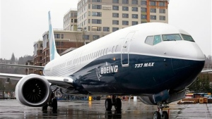 FILE - In this March 7, 2017, file photo, the first of the large Boeing 737 MAX 9 models, Boeing's newest commercial airplane, sits outside its production plant in Renton, Wash. (AP Photo/Elaine Thompson, File)