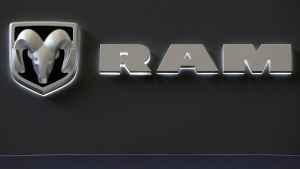 In this Feb. 14, 2013 photo, the Dodge Ram truck logo appears on a sign at the 2013 Pittsburgh Auto Show in Pittsburgh. (AP Photo/Gene J. Puskar)