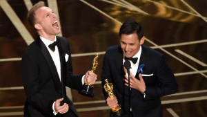 """This Feb. 26, 2017, shows Justin Paul, left and Benj Pasek, right, accepting the award for best original song for """"City of Stars"""" from """"La La Land"""" at the Oscars at the Dolby Theatre in Los Angeles. (Photo by Chris Pizzello/Invision/AP, File)"""