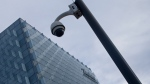 A security camera stands outside the main Telefonica headquarters in Madrid, Spain, Friday, May 12, 2017.  The Spanish government said several companies including Telefonica had been targeted in ransomware cyberattack that affected the Windows operating system of employees' computers. It said the attacks were carried out with a version of WannaCry ransomware that encrypted files and prompted a demand for money transfers to free up the system. (AP Photo/Paul White)