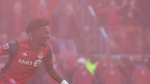 Toronto FC Tosaint Ricketts turns to celebrate through the haze of a smoke flare after scoring his team's winning third goal against Minnesota United during second half MLS action in Toronto on Saturday, May 13, 2017. THE CANADIAN PRESS/Chris Young