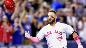 Toronto Blue Jays outfielder Kevin Pillar (11) celebrates his game winning home run against the Seattle Mariners during ninth inning American League baseball action in Toronto, Sunday, May 14, 2017. THE CANADIAN PRESS/Frank Gunn