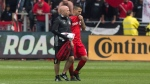Toronto FC forward Sebastian Giovinco (right) leaves the field with a trainer after suffering an injury during first half MLS action against Minnesota United in Toronto on Saturday, May 13, 2017. THE CANADIAN PRESS/Chris Young