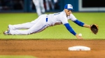 Toronto Blue Jays Ryan Goins dives for a ball against the Atlanta Braves during the fifth inning of MLB interleague baseball action in Toronto, Monday May 15, 2017. (Mark Blinch/The Canadian Press)