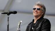 Musician Jon Bon Jovi performs during a surprise appearance at the Fairleigh Dickinson University commencement ceremony, Tuesday, May 16, 2017, at MetLife Stadium in East Rutherford, N.J. The school won a nationwide contest to bring the New Jersey-based band Bon Jovi to play their graduation by generating the most interest on social media. (AP Photo/Julio Cortez)