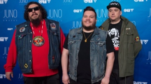 A Tribe Called Red pose on the red carpet as they arrive at the Juno awards show Sunday April 2, 2017 in Ottawa. THE CANADIAN PRESS/Sean Kilpatrick