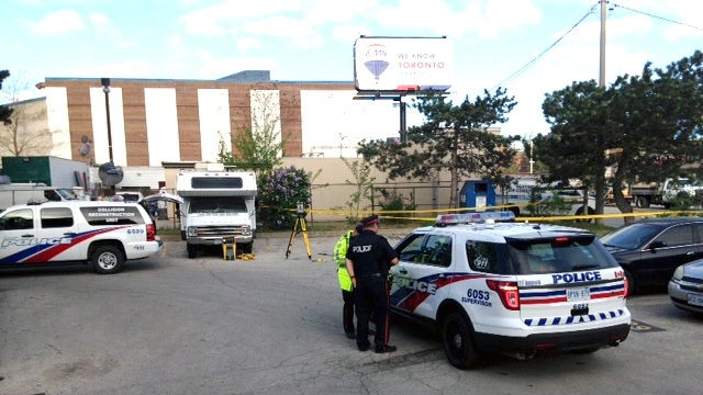 Emergency crews block off an area of a parking lot in Warren Park where a woman was found critically injured. (Cam Woolley/CP24)