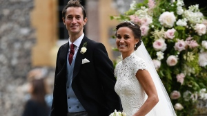 Pippa Middleton, right and James Matthews walk, after their wedding at St Mark's Church in Englefield, England, Saturday, May 20, 2017. (Justin Tallis/Pool Photo via AP)