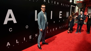 """Michael Fassbender, a cast member in """"Alien: Covenant,"""" poses before a hand and footprint ceremony for the film's director Sir Ridley Scott at the TCL Chinese Theatre on Wednesday, May 17, 2017, in Los Angeles. (Photo by Chris Pizzello/Invision/AP)"""