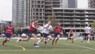 Toronto Wolfpack's Andrew Dixon (centre) breaks through to score against Oxford during their 62-12 win in their inaugural home opener in Kingstone Press League 1 Rugby action in Toronto on Saturday, May 6, 2017. THE CANADIAN PRESS/Chris Young