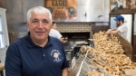 Joe Morena stands in his bagel shop Sunday, May 21, 2017 in Montreal. St-Viateur bagel celebrated 60 years of bagel-making with a block party in Montreal's Mile End neighbourhood Sunday. THE CANADIAN PRESS/Paul Chiasson